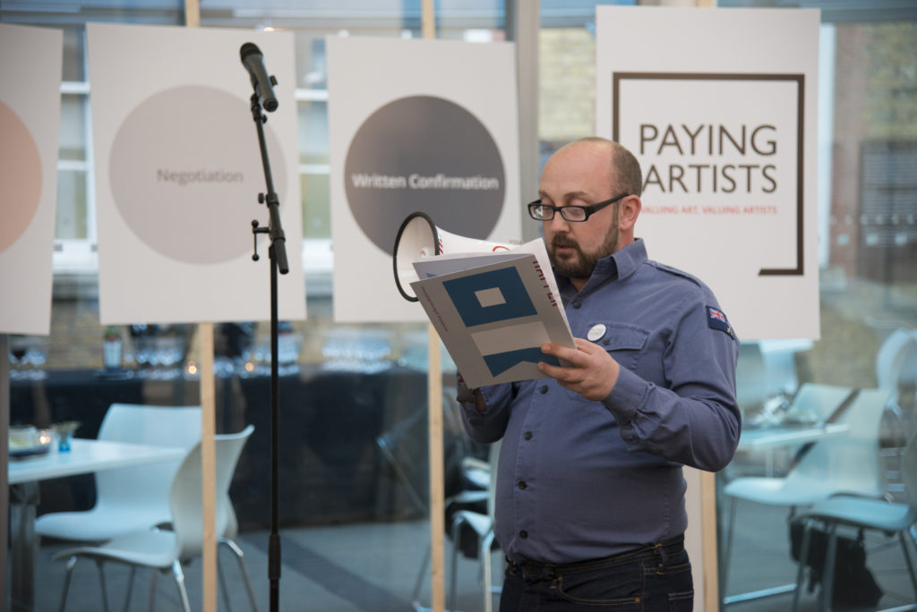 Dan Thompson's performance in support of his Paying Artists Artist-led Manifesto at the launch of Exhibition Payment: The a-n/AIR Paying Artists Guide. Photo: Kirstin Sinclair